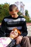 Boy and girl. Girl lie on the boy in the park Royalty Free Stock Photography