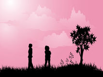 Boy and girl. Silhouettes of boy and girl outside Royalty Free Stock Photo