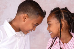 Boy and girl. A brother and sister facing each other looking into each others eyes Royalty Free Stock Photography