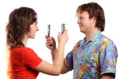 Boy and girl. Take pictures each other Stock Photos
