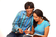 Boy and girl. Studying  over a white background Stock Photography