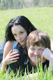 Boy and girl. On the meadow Stock Photos