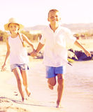 Boy and girl actively jogging together Stock Photography