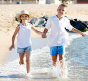 Boy and girl actively jogging together Royalty Free Stock Image