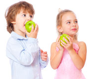 Boy and girl with apples. Isolated on white background Stock Image