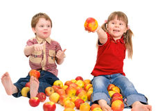 Boy and the girl with apples Stock Photos
