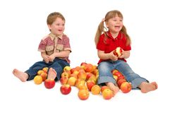 The boy and the girl with apples Royalty Free Stock Photography
