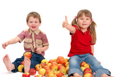 The boy and the girl with apples Stock Photography