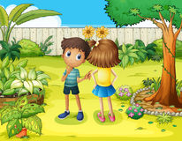 A boy and a girl arguing in the garden Royalty Free Stock Photos