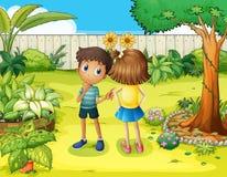 A boy and a girl arguing in the garden Royalty Free Stock Photos