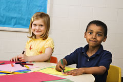 Boy and Girl in Art Class. Smiling boy and girl doing projects in art class. Horizontally framed shot stock photos