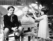 Boy and girl in an artist studio Royalty Free Stock Photos