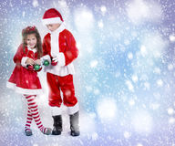 Boy and girl as santa and elf Stock Images
