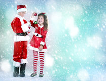 Boy and girl as santa and elf Stock Photo