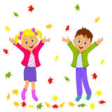 Boy and girl and autumn leaves Royalty Free Stock Image