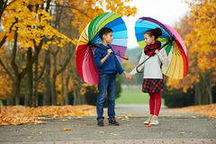 Boy and girl in autumn park Stock Image