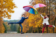 Boy and girl in autumn park Royalty Free Stock Image