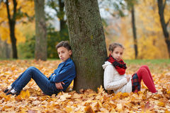 Boy and girl in autumn park Royalty Free Stock Photography