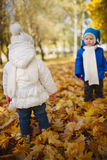 Boy and girl in autumn park Royalty Free Stock Images