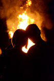 The boy and girl on the background of fire (love, relationships, Stock Photography