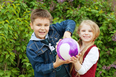 Boy and girl with a ball Royalty Free Stock Photos