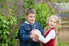 Boy and girl with ball Royalty Free Stock Images