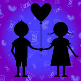 Boy and girl with baloon. Stock Photo