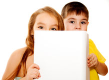 Boy and girl with a banner Royalty Free Stock Photos