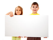 Boy and girl with a banner Royalty Free Stock Photography