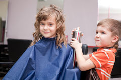Boy and girl in barbershop Stock Images