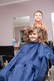 Boy and girl in barbershop Royalty Free Stock Photo