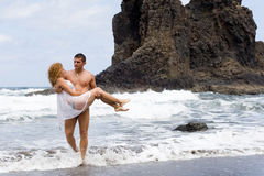 Boy and girl on the beach stock photography