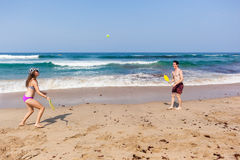 Boy Girl Beach Ocean Bat Ball Playtime Stock Image