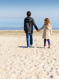 Boy and girl beach walk Royalty Free Stock Photography