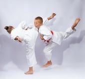 Boy and girl are beating kick leg Royalty Free Stock Image