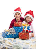 Boy and girl in bed with Christmas presents Stock Image