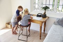 Boy And Girl In Bedroom With Digital Tablet Doing Homework Royalty Free Stock Photo
