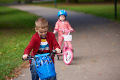Boy and girl with bicycle Stock Images