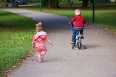 Boy and girl with bicycle Royalty Free Stock Image