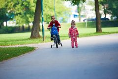 Boy and girl with bicycle Royalty Free Stock Images