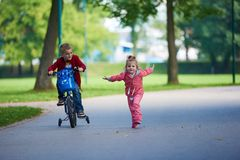 Boy and girl with bicycle Stock Image