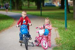 Boy and girl with bicycle Royalty Free Stock Photo