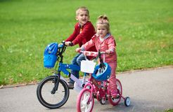 Boy and girl with bicycle Stock Photo