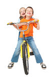 Boy and girl on bicycle Royalty Free Stock Photos