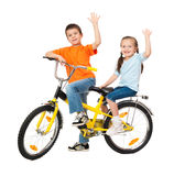 Boy and girl on bicycle isolated Stock Photography
