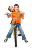 Boy and girl on bicycle isolated Royalty Free Stock Photography