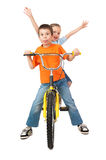 Boy and girl on bicycle isolated Stock Photos