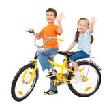 Boy and girl on bicycle isolated Royalty Free Stock Photos