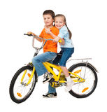 Boy and girl on bicycle on white Stock Image