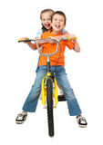 Boy and girl on bicycle on white Stock Photography